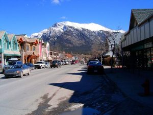 Main street canmore with mountain in the background